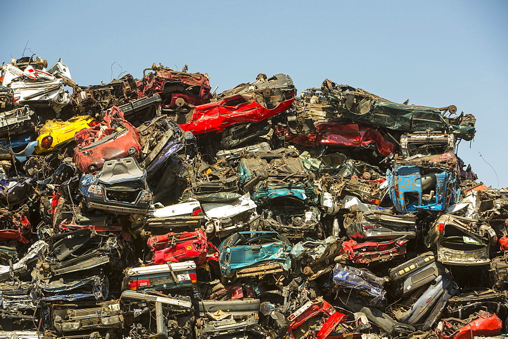 Old cars at a scrap metal merchants on the docks in Amsterdam, Netherlands, Europe