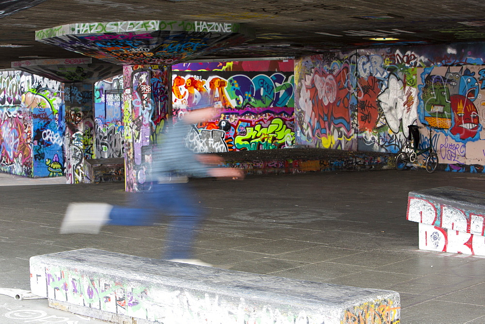 Skateboarders leaping obstacles on London's South Bank, London, England, United Kingdom, Europe