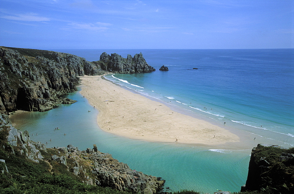 Porthcurno beach near the Minnack Theatre in West Cornwall. Lagoon at low tide.