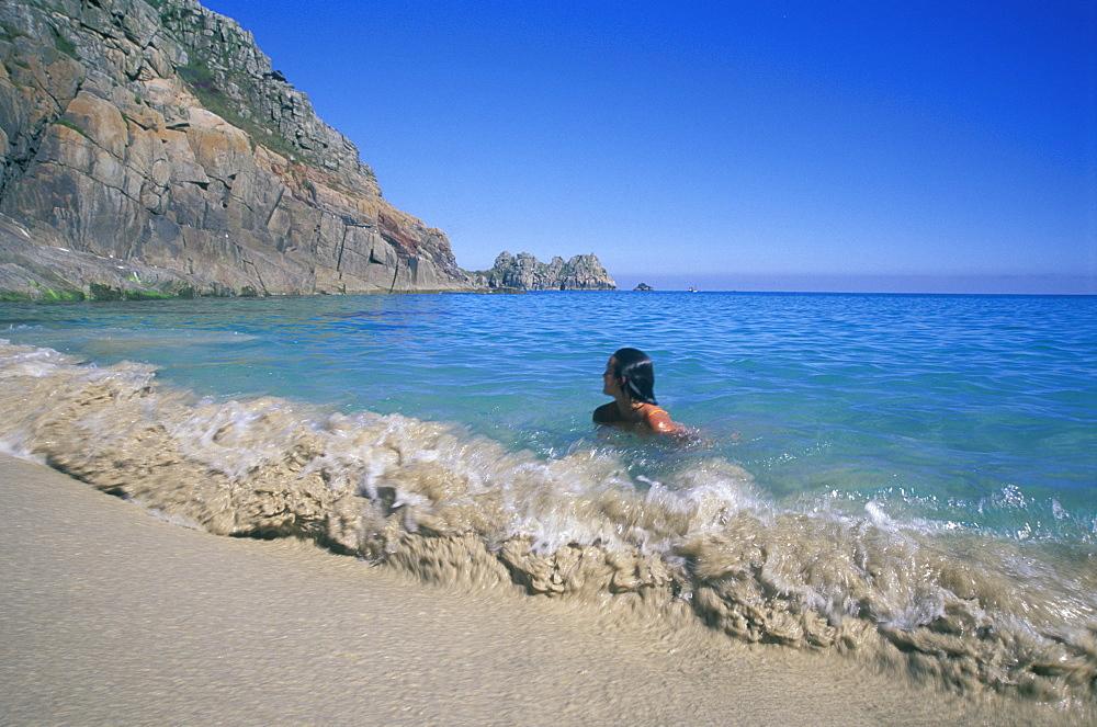 Swimming in sea. Porthcurno beach near the Minnack Theatre in West Cornwall      (rr)