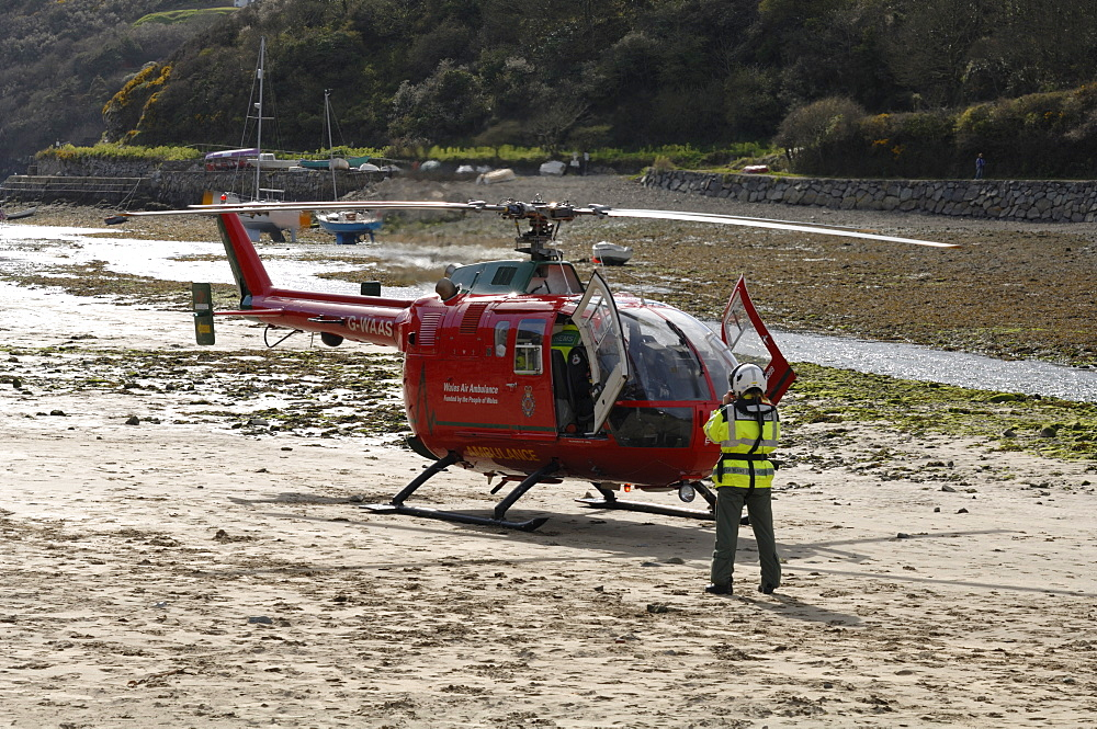 Wales Air Ambulance helicopter and crew rescuing a casualty at Solva harbour, Solva, Pembrokeshire, Wales, UK, Europe
