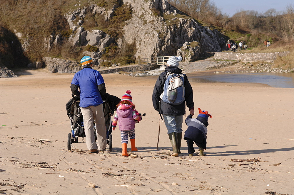 Two mothers pushing pushchairs and children on beach, Broad Haven South, Stackpole, Pembrokeshire, Wales, UK, Europe