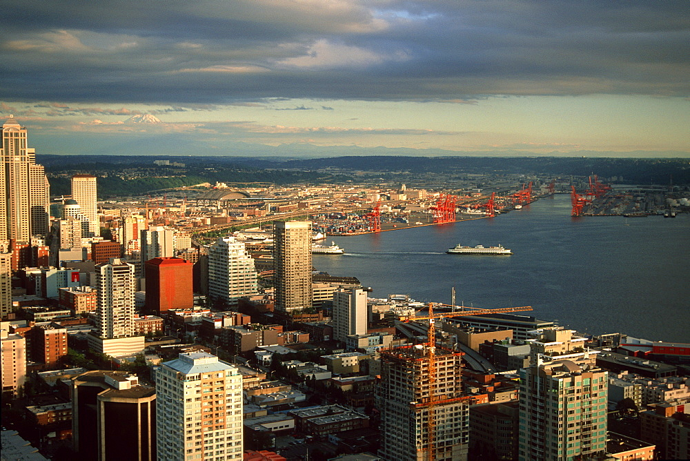 Downtown buildings overlooking Puget Sound at dusk, Seattle, Washington, United States of America, North America