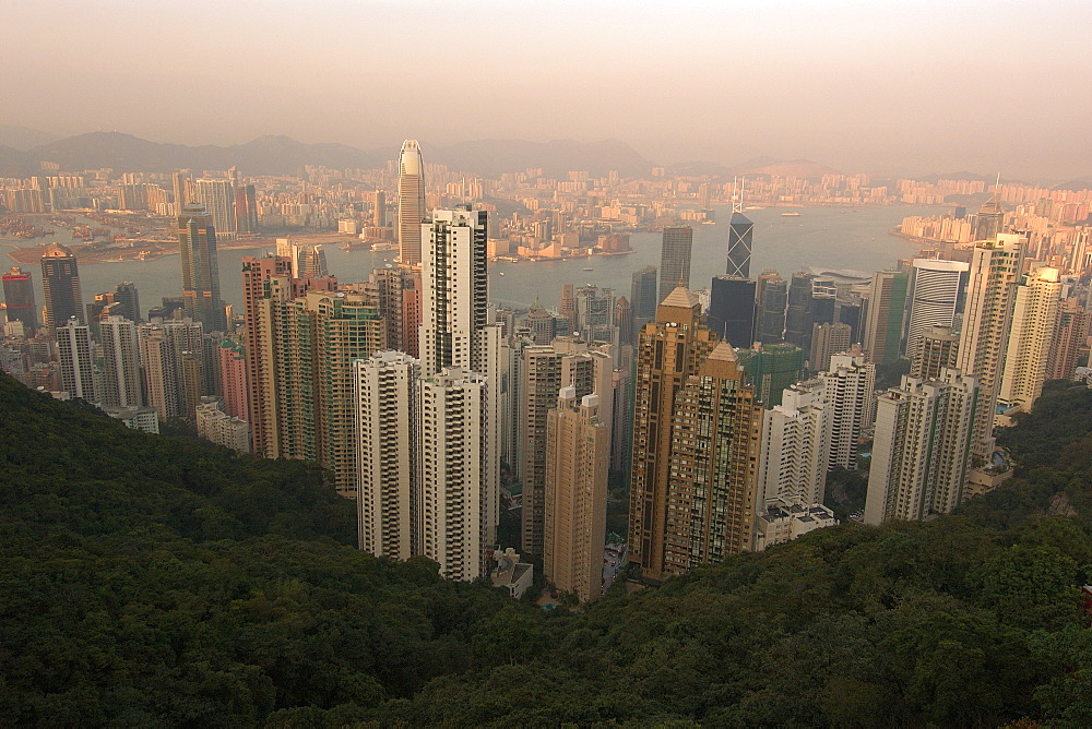 Hong Kong's modern skyline overlooking Victoria harbour and Kowloon peninsula at dusk, Hong Kong, China, Asia - 920-1489