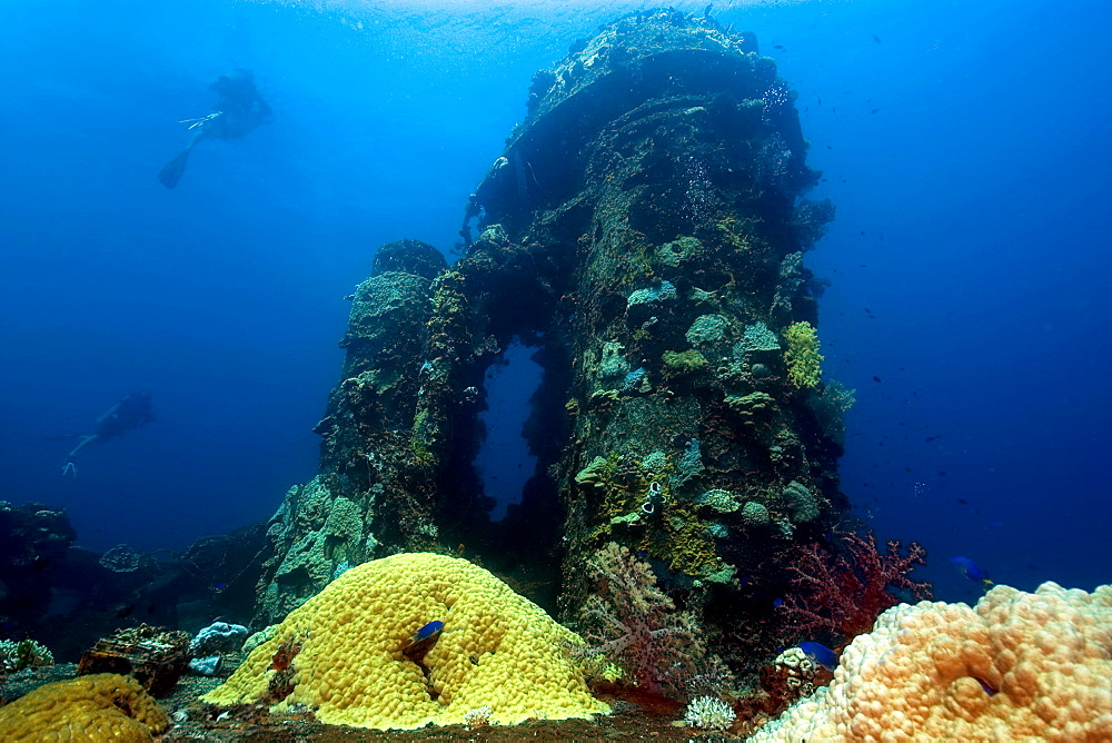 Divers explore the main deck, Fujikawa Maru shipwreck, Truk lagoon, Chuuk, Federated States of Micronesia, Caroline Islands, Micronesia, Pacific Ocean, Pacific