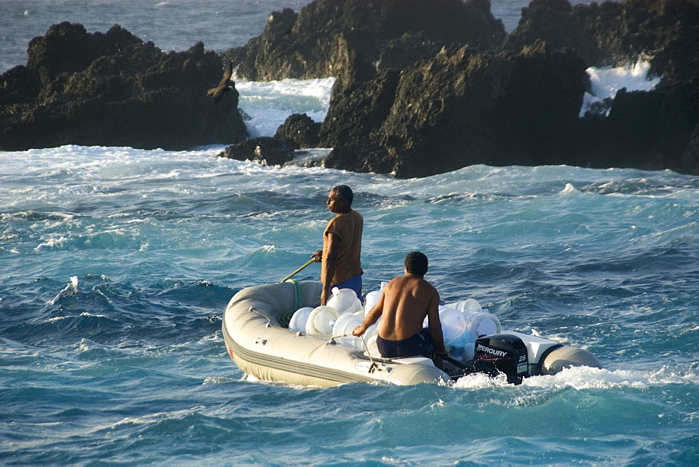 Skiff transporting water, St. Peter and St. Paul's rocks, Brazil, South America