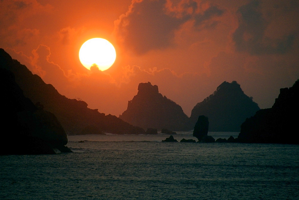 Sunset and Dois Irmaos islands, Fernando de Noronha national marine sanctuary, UNESCO World Heritage Site, Pernambuco, Brazil, South America