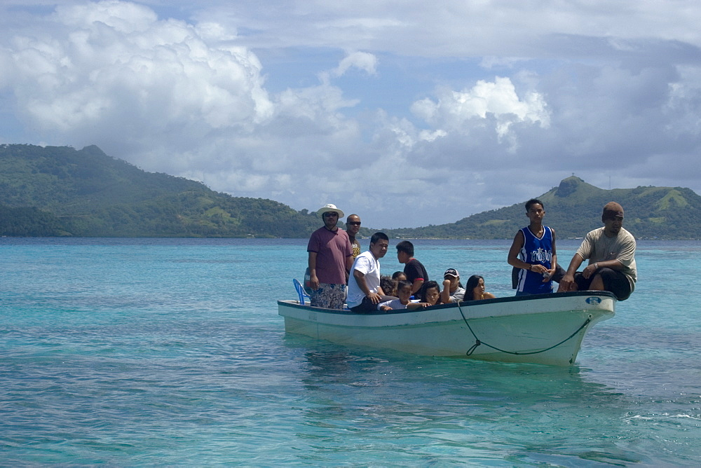 Boat with local family approaches island for a day trip, Truk lagoon, Chuuk, Federated States of Micronesia, Caroline Islands, Micronesia, Pacific Ocean, Pacific