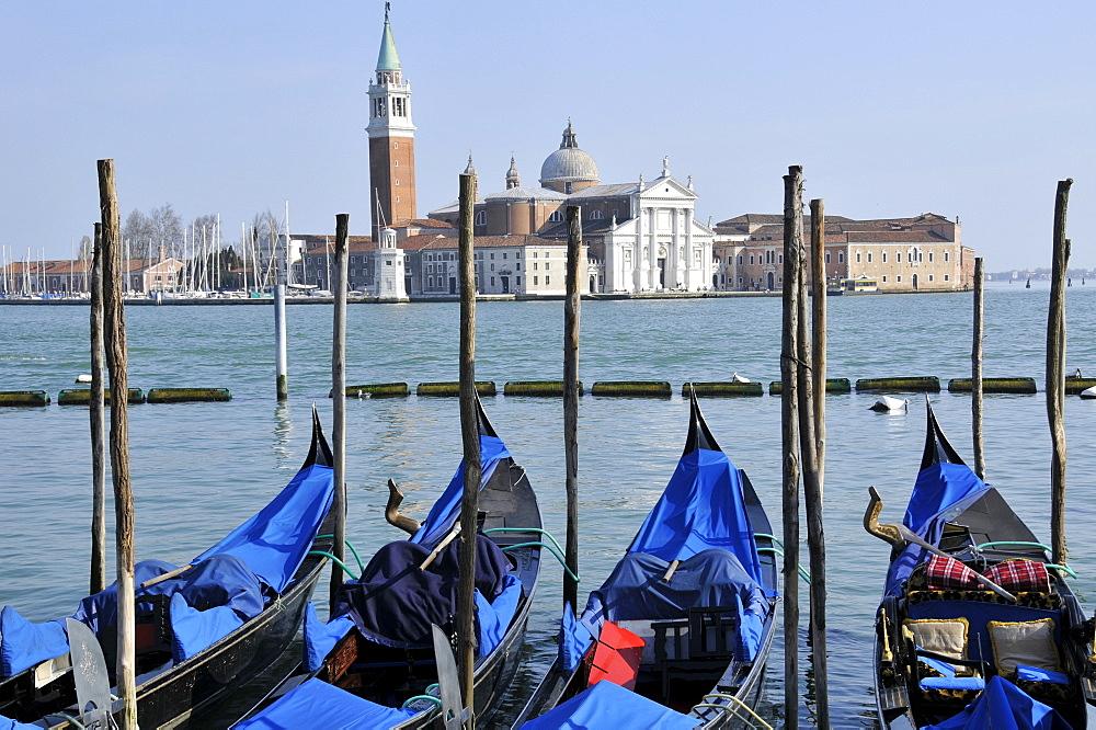 Four gondolas parked in Venetian lagoon, with San Giorgio Maggiore Island in the background, Venice, UNESCO World Heritage Site, Veneto, Italy, Europe