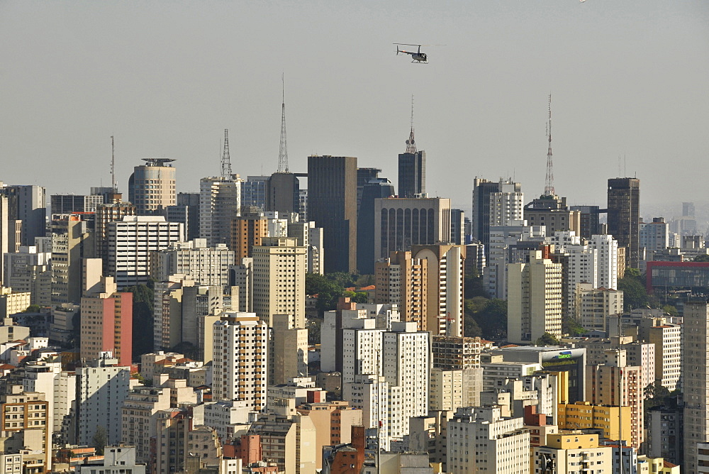 Sao Paulo and helicopter, view from the rooftop of Italia Building, Brazil, South America