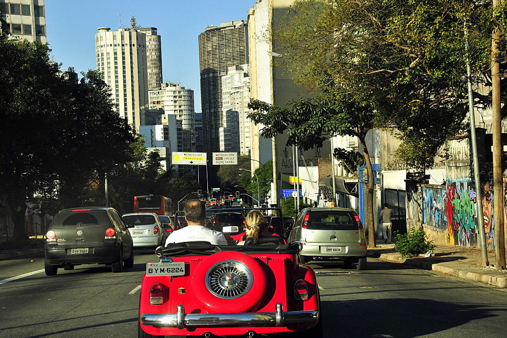 Red car on Consolacao Avenue, downtown Sao Paulo, Brazil, South America