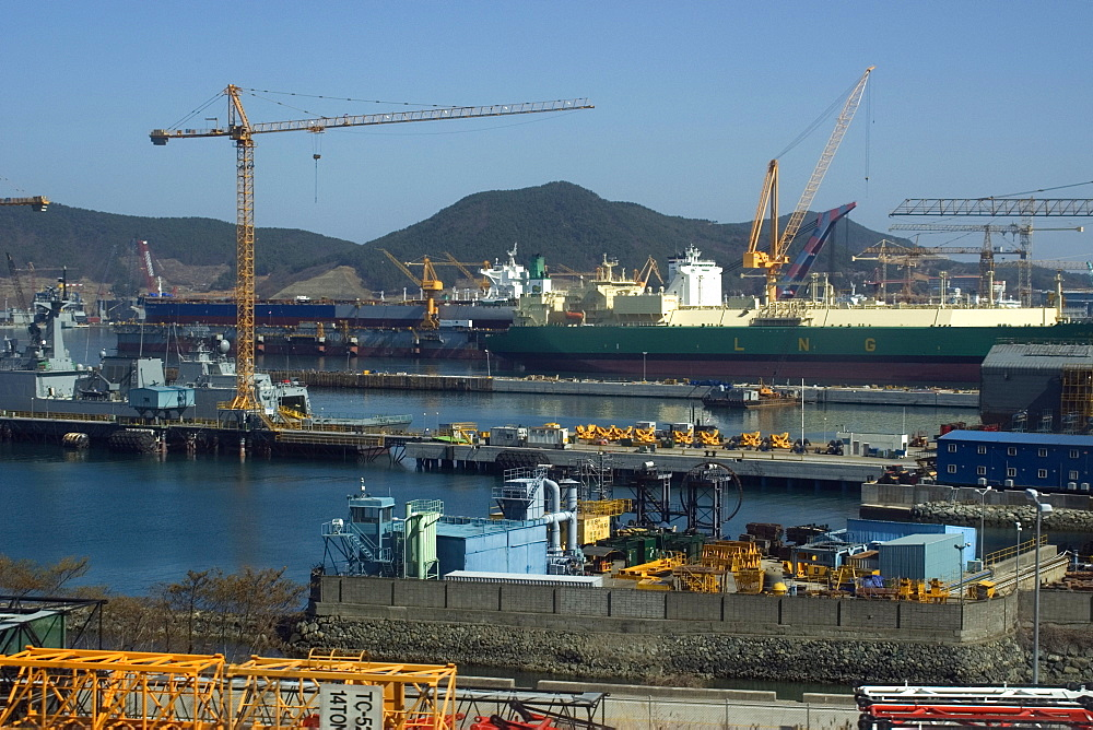 Heavy cranes, machinery and ships under construction at Samsung shipyard, Geoje-Do, South Korea, Asia - 920-996