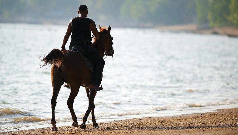 Horse riding along beach, Ao Nam Mao.  Ao Nang, Krabi, Thailand, Asia