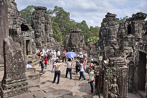 Tourists at The Bayon, Angkor Thom, Angkor, UNESCO World Heritage Site, Siem Reap, Cambodia, Indochina, Southeast Asia, Asia  - 921-1229