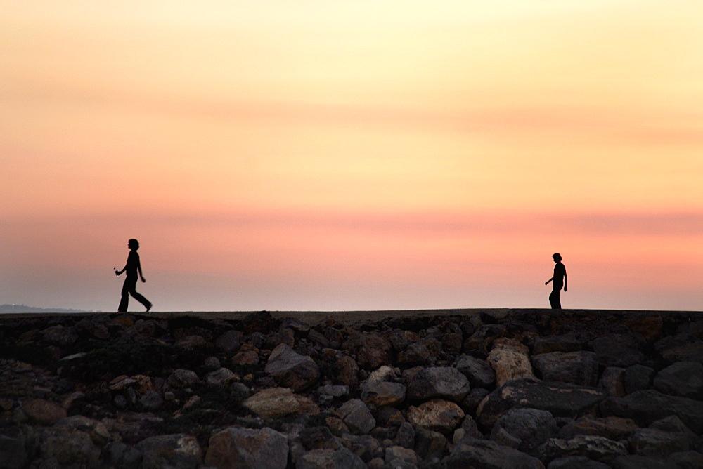 Break wall, beach front, sun set, afternoon, walk
