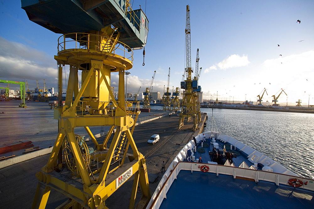 Dock Yards, crane, industry, Ship Clipper Adventurer, entering port, evening. Casablanca, Port Of Casablanca, Morocco