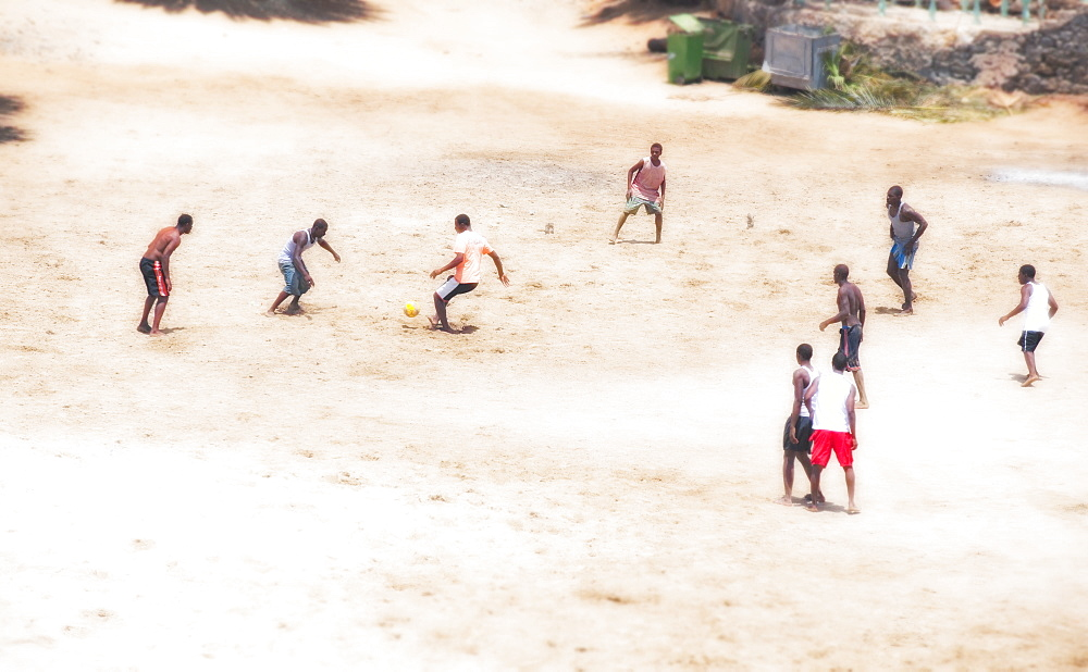 03/04/2009. Tarrafal bay Town Beach. Children and teenagers enjoy their local beach in the mid day. The Cape Verde islands have a large population percentage of youths. . Praia, Tarrafal , Sao Tiago Island. Cape Verde - 921-506