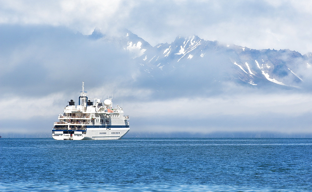 the ship Clipper Odyssey, mountains, snow caped, arfternoon, 27/06/2008, Bogoslov Island (Bering Sea) Russia, Asia