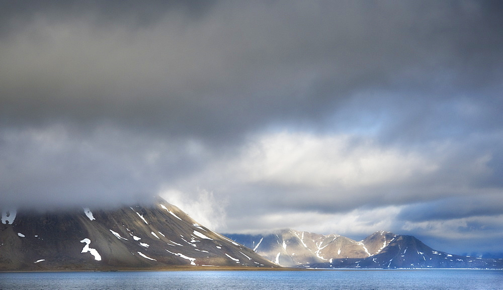 Landscape scenic view with snow caped mountains, ocean, and clouds, Penkigney Fjord (Bering Sea ) Russia, Asia - 921-698