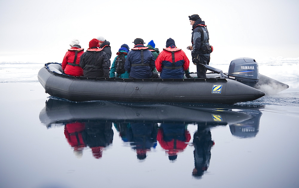 Zodiac, boat, cruise. tourists, arctic sheet ice. Longyearbyen, Svalbard, Norway