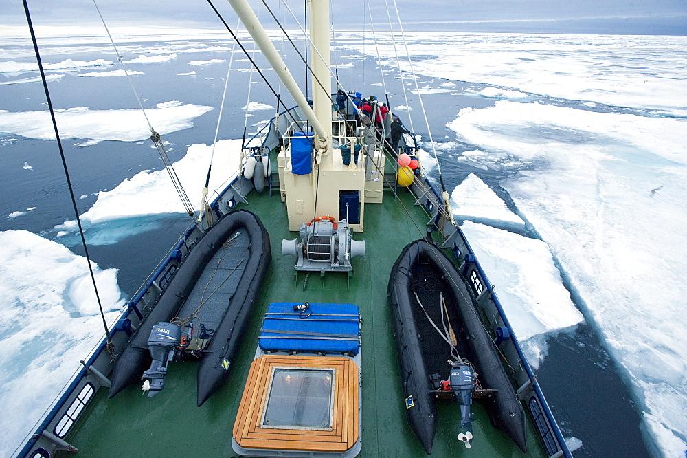 Zodiac, boat, cruise. tourists, arctic sheet ice. Longyearbyen, Svalbard, Norway       (rr)