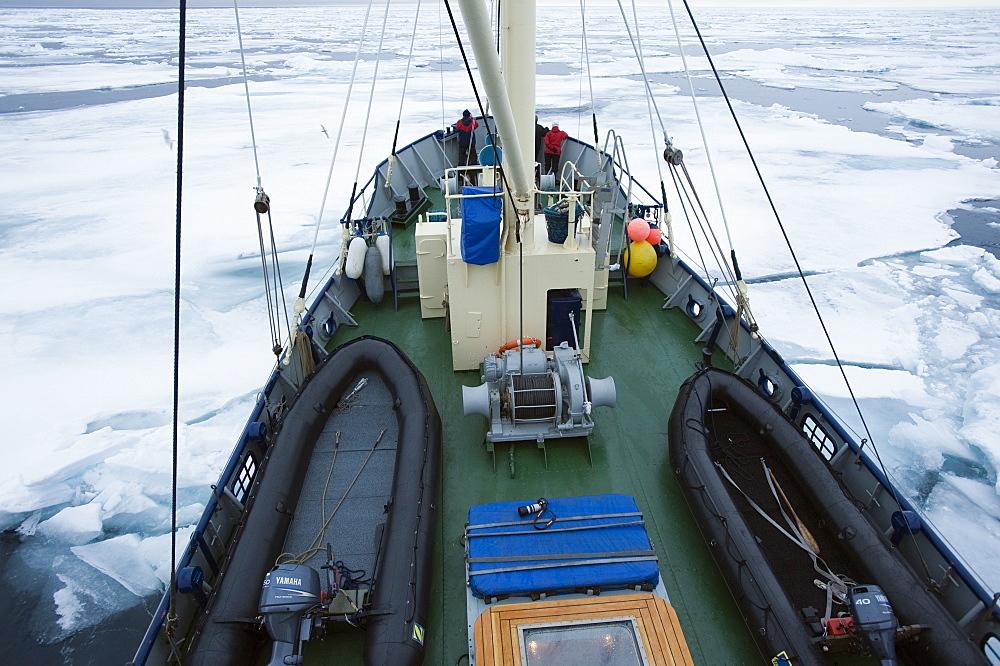Zodiac, boat, cruise. tourists, arctic sheet ice, ice breaker. Longyearbyen, Svalbard, Norway