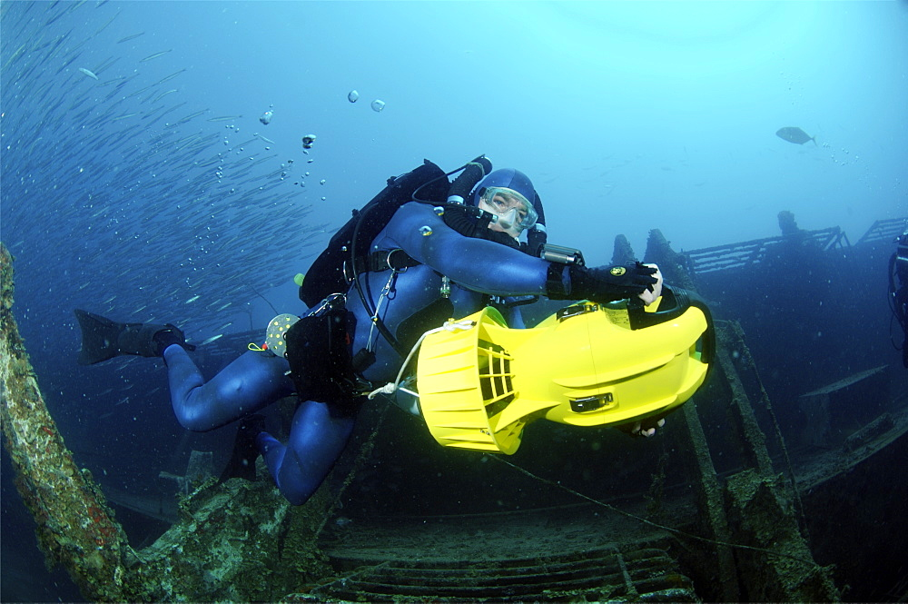 Mixed gas rebreather diver using scooter for mobility.  Red Sea.