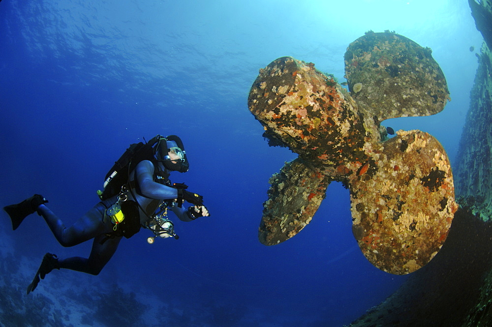 Mixed gas rebreather divers by ship wreck, with propeller in tact.  Red Sea.