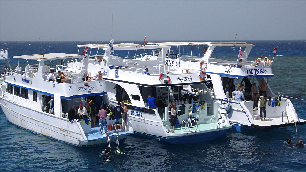 Red Sea diving boats moors on reef near Hurghada. Egypt