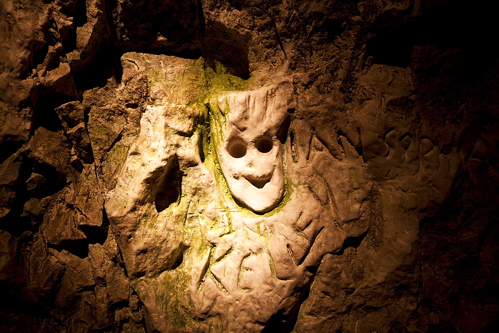 Chalk carving of face in hand-dug tunnel, Hell-Fire Caves, West Wycombe, Buckinghamshire, England, United Kingdom, Europe