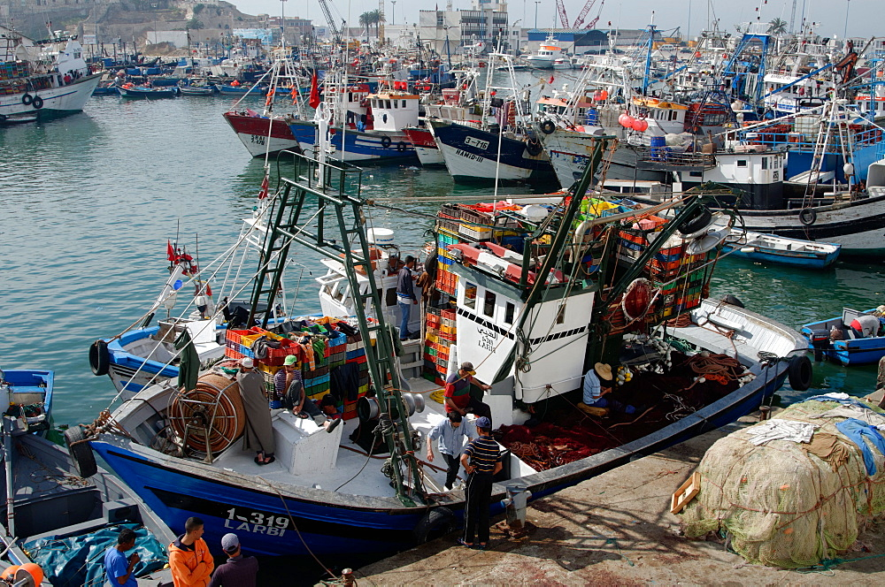 Fishing boat preparing to set sail from Tangier fishing harbour, Tangier, Morocco, North Africa, Africa - 971-123