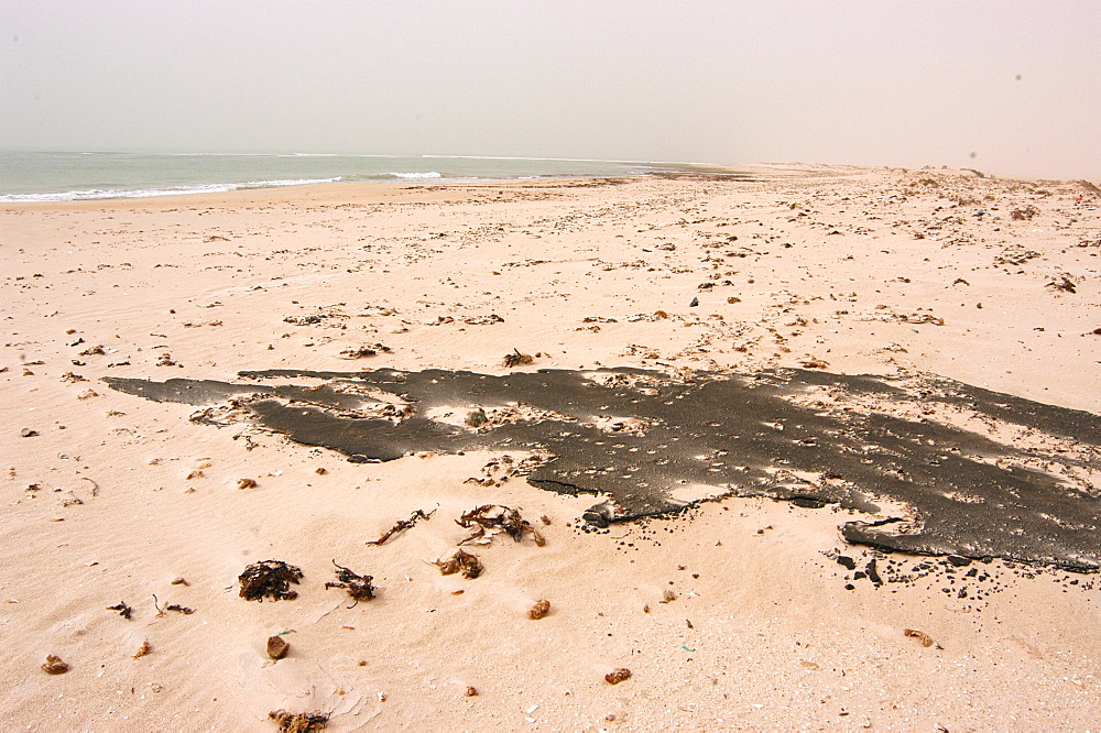 Weathered oil slick on beach, Southern Morocco   (RR)