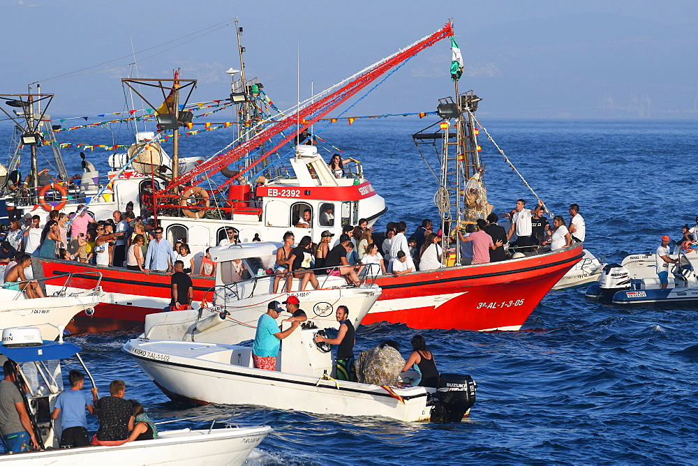 Chaotic scene at sea, as the Virgen del Carmen from Tarifa is taken on an annual ritual voyage with small boats in attendance, Cadiz, Andalusia, Spain, Europe - 971-227
