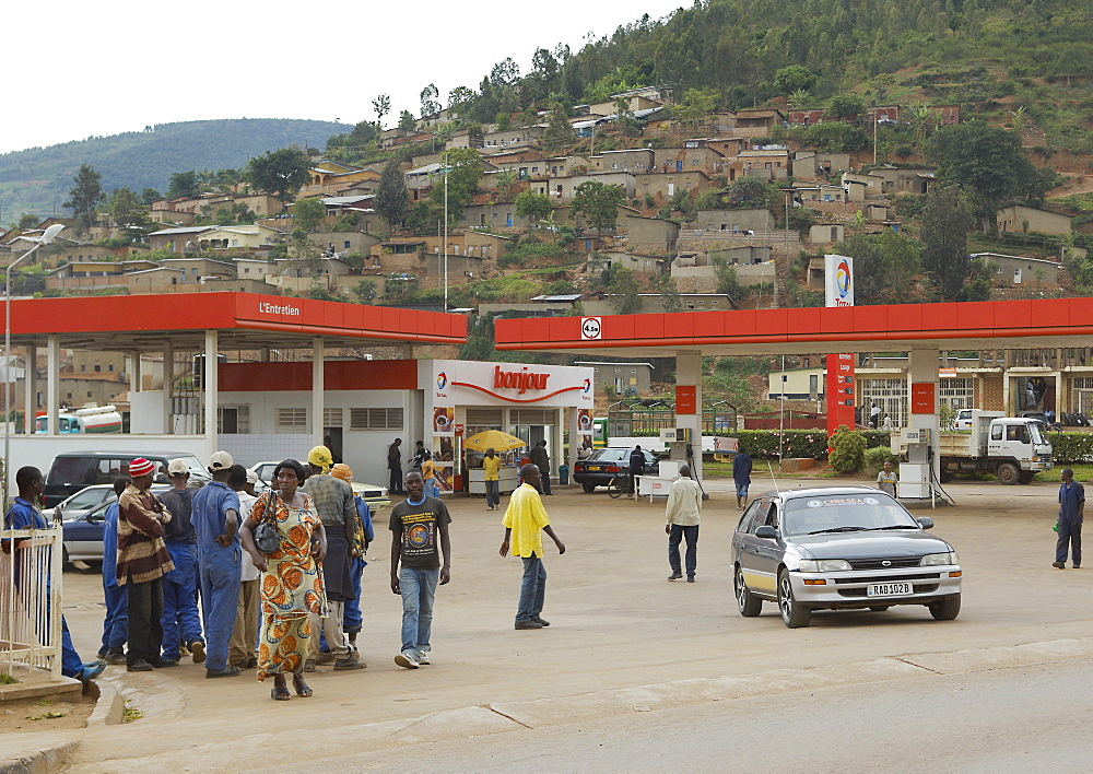 Acting as beacons of Western wealth and power, Petrol stations, usually the cleanest, most colourful and well staffed of any facility in Rwanda, regularly facilitate gatherings. Kigali, Rwanda, East Africa