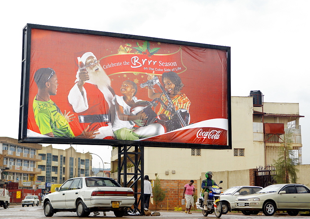 A bill board advertising Coca Cola at Christmas time with a truly Rwandan Twist.  It's prominence illustrates the far reaching appeal of the brand. Kigali, Rwanda, East Africa