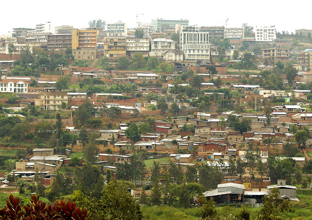 Kigali, population 965,398 (2009), is the capital and largest city of Rwanda. It is situated near the geographic centre of the nation, and has been the economic, cultural, and transport hub of Rwanda since it became capital at independence in 1962.  Government/Administrative sector is located away from the City Centre. Kigali, Rwanda, East Africa