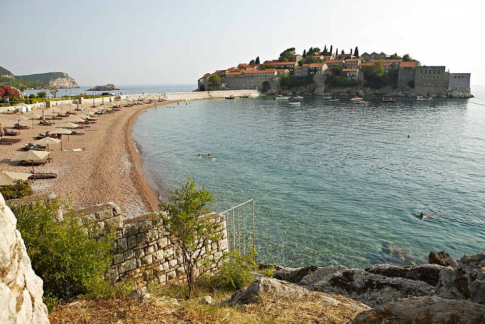 The small islet of Sveti Stefan, now an exclusive Aman hotel resort, Budva, Montenegro, Europe