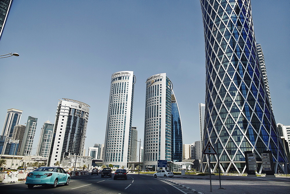 Downtown Doha with its impressive skyline of skyscrapers, Doha, Qatar, Middle East - 975-256