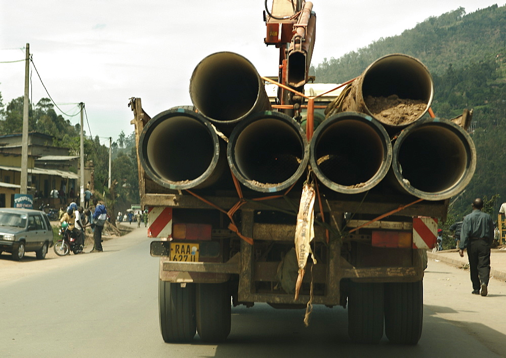 Construction lorry loaded with materials for pipe work.  Kigali, Rwanda. Kigali, Rwanda, East Africa