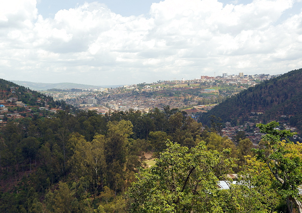 Spanning several Hills, Kigali, the capital City of Rwanda.  Here you can see the City Centre with the Adjacent hills filling up with housing for the ever increasing population. Kigali, Rwanda, East Africa