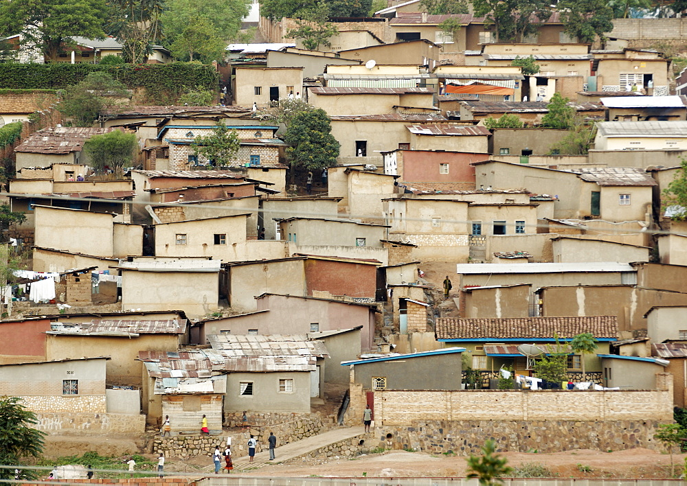 Like a patchwork quilt covering many of the steep hills of Kigali, this housing in some of the poorer areas of Kigali house a high proportion of the population and are commonplace throughout the Capitol City. Kigali, Rwanda, East Africa