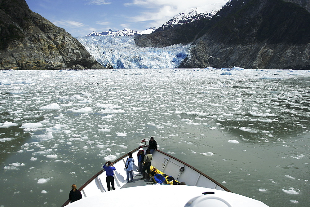 Working a boat through the ice of the Sawyer Glacier, a tidewater glacier at the end of Tracy Arm in Southeast Alaska, USA.