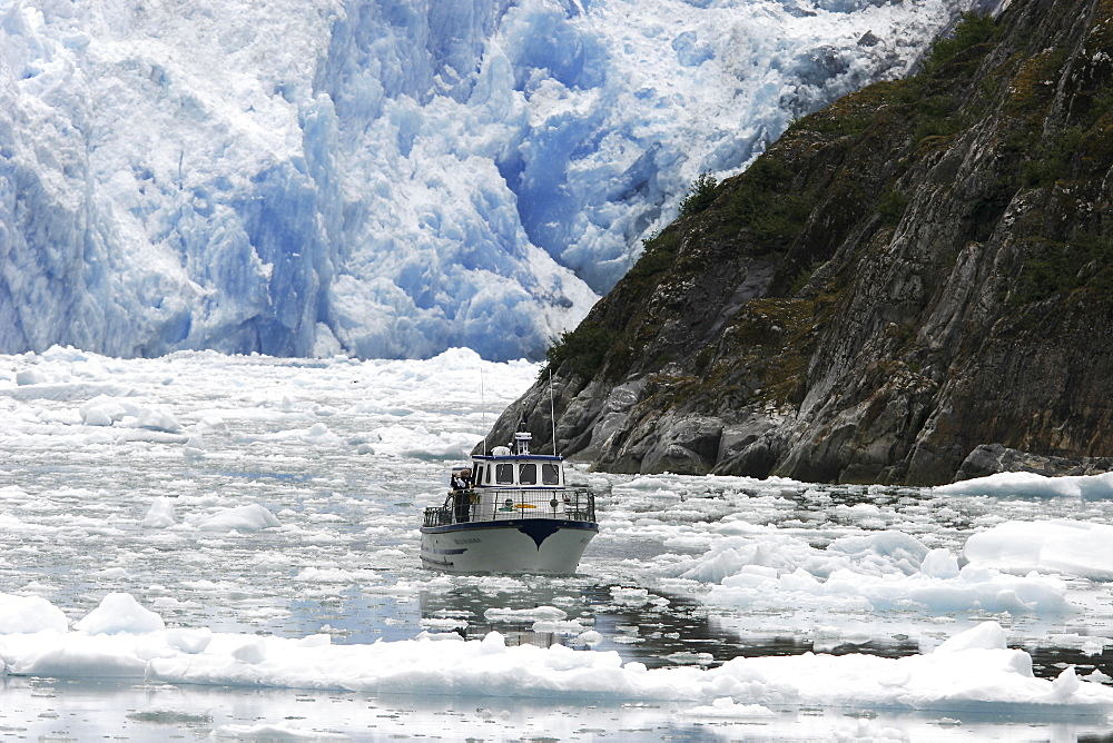 A tour ship navigates the ice of the Le Conte and Patterson Glaciers, the Stikine Ice Field, and the mountains surrounding the town of Petersburg, Southeast Alaska, USA.