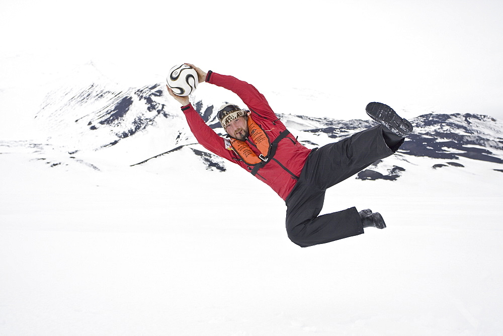 Head chef Tommi of the Lindblad Expedition ship National Geographic Endeavour at  play in Antarctica. No model release.