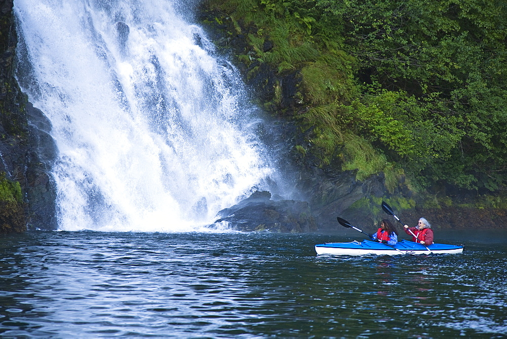 Kayaking in Red Bluff Bay on Baranof Island in Southeast Alaska, USA. Pacific Ocean. Kayak property release is DB051905. No model release.
