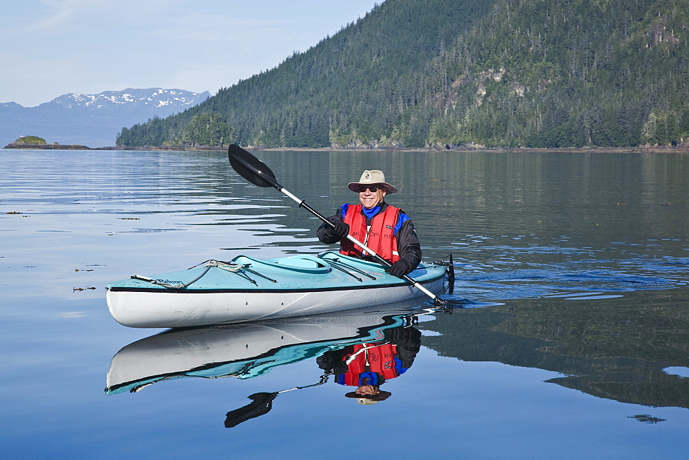 Kayaking in Windham Bay in Southeast Alaska, USA. Pacific Ocean. Kayak property release is DB051905. No model release.