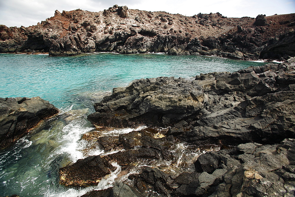 Volcanic rock shoreline on Ascension Island in the south Atlantic Ocean.