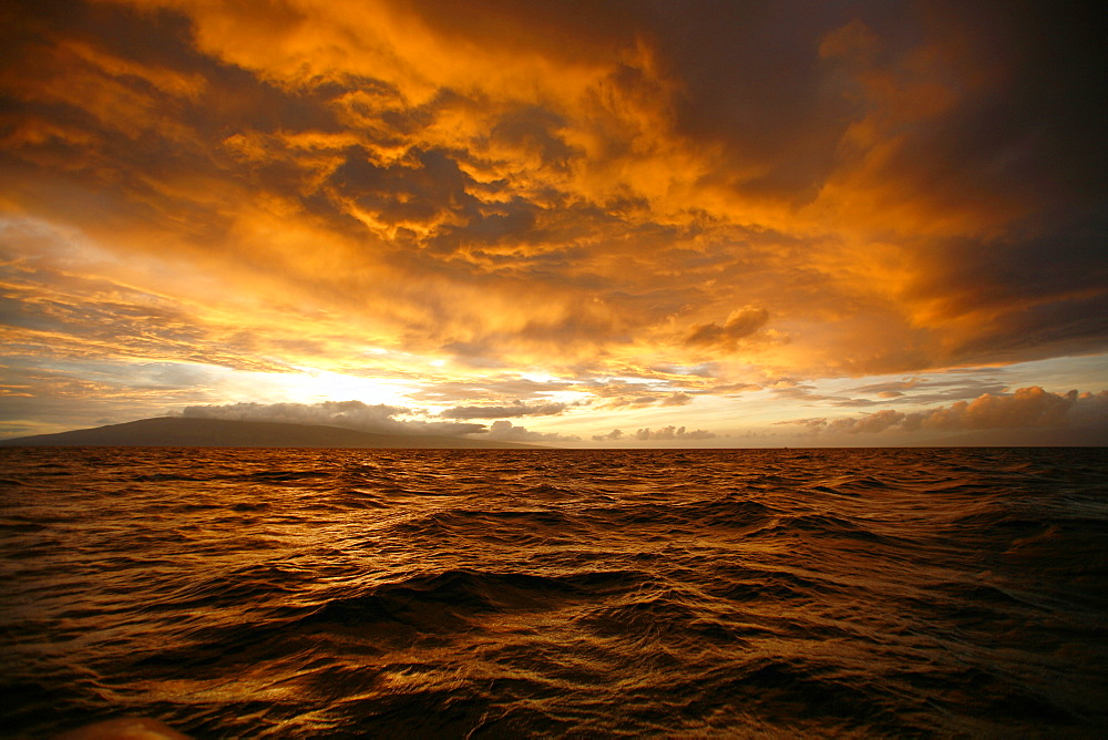 Sunset across the AuAu Channel between Maui and Lanai, looking west with Lanai in the background. Maui, Hawaii, USA.
