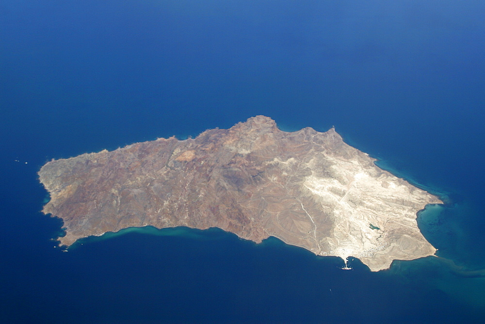 An aerial view of Isla San Marcos off the Baja Peninsula on the Gulf of California (Sea of Cortez) side. Baja California, Mexico. Note the dock and white gypsum mine operation on the lower (SW) side of the island.