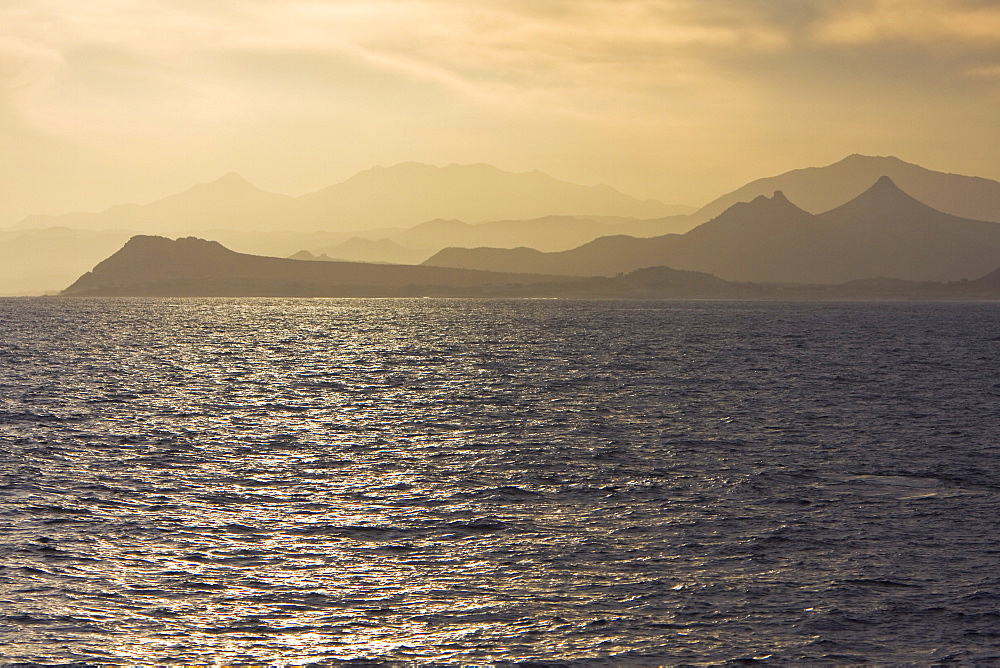 Sunset over the southern Baja Peninsula in Baja California Sur, Mexico. This photo is taken from a boat on the Gulf of California (Sea of Cortez) side of the peninsula.